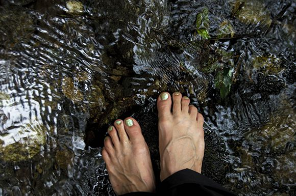 Barefoot by a stream